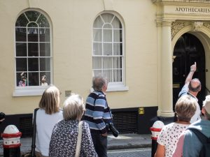 Club Members are reflected in the window as our guide, Ian Swankie, explains about Apothecaries Hall