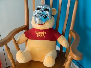 Why is Winnie the Pooh wearing a skull Mask?